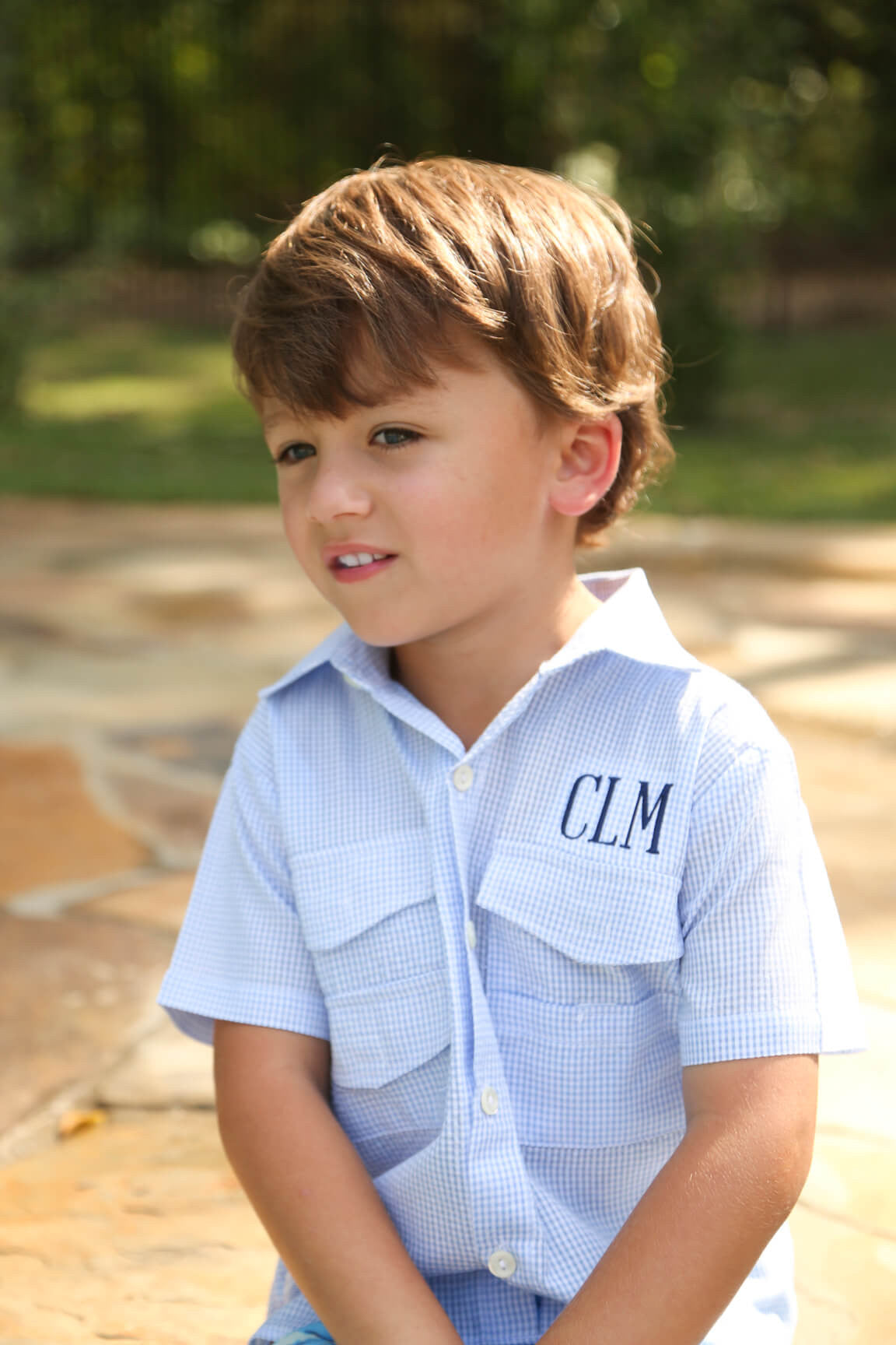 Boy Wearing the Blue Seersucker Fishing Shirt with Mesh Lining and Velcro Pockets by Eliza James Kids