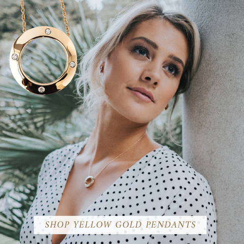 Young lady wearing a gold pendant