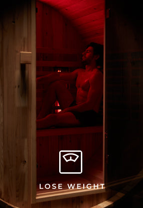 Man losing weight by using an infrared sauna