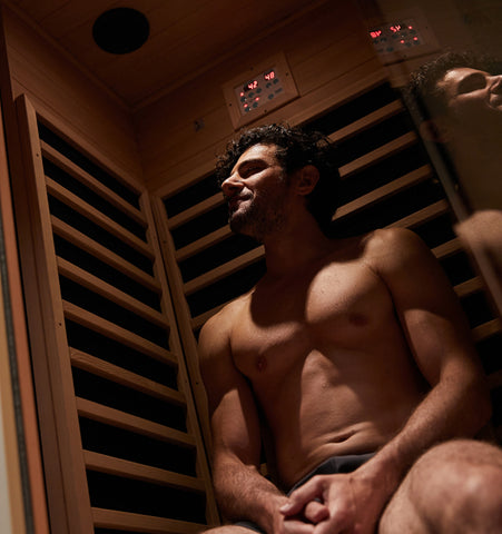 Man sitting in an infrared sauna for muscle recovery