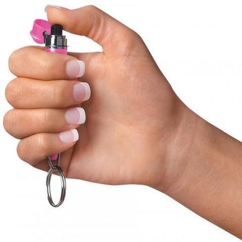 Mini MACE Pepper Spray Pink Holding In Hand