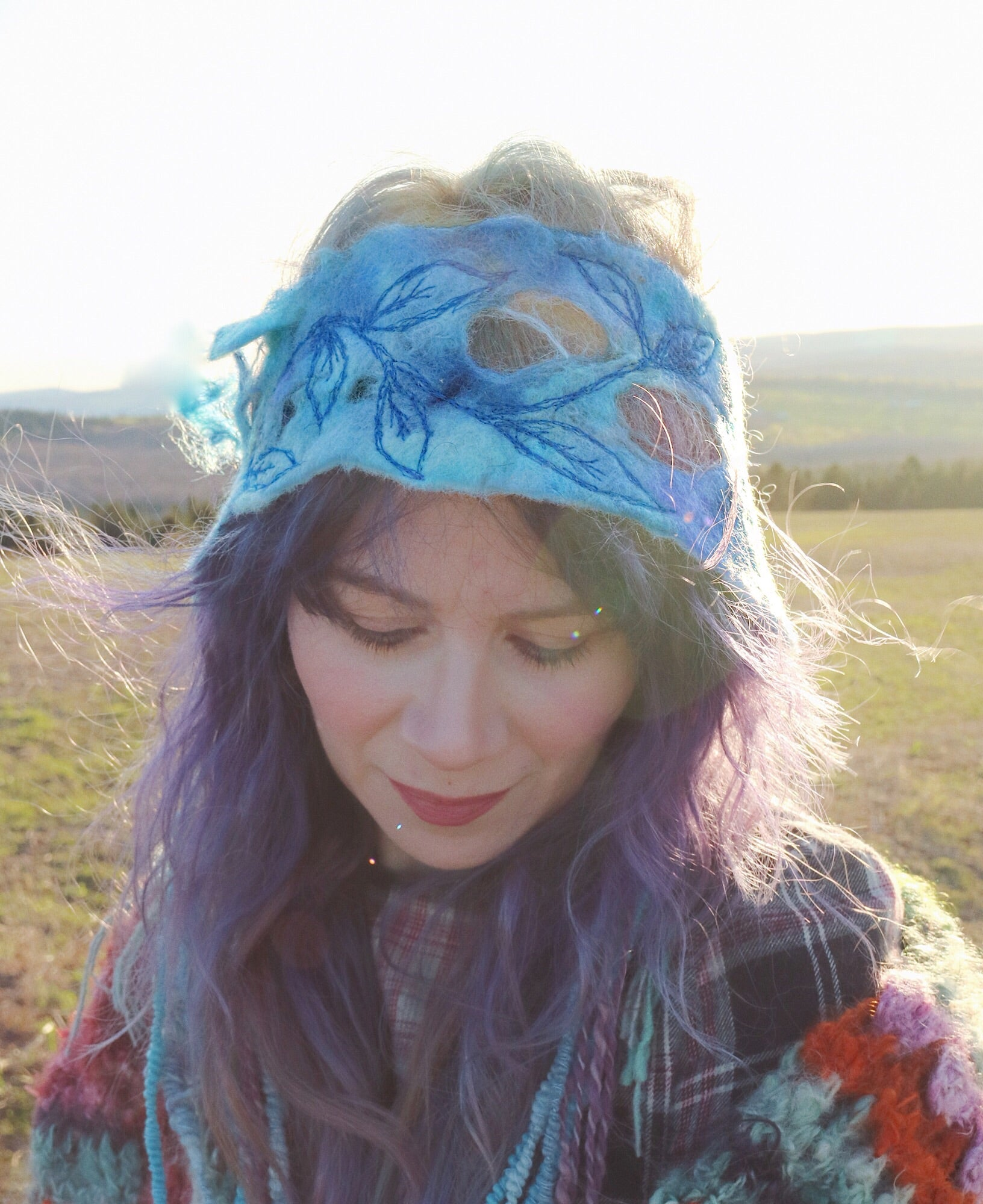 Blue felted headband with embroidery