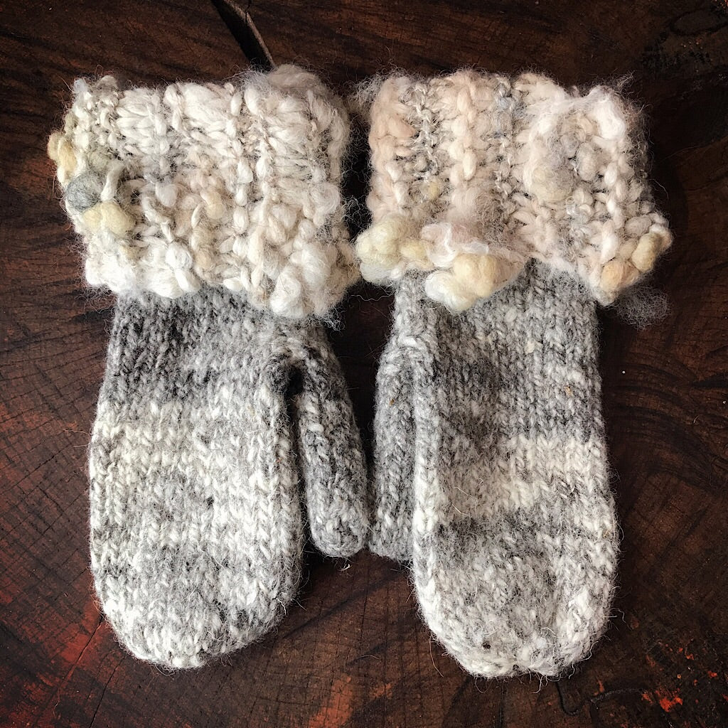 Grey knitted mittens