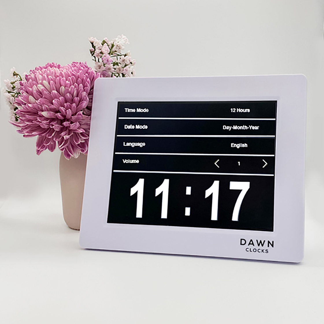 Original Dawn Clock shown on a table with a menu example on the screen. This is ideal for all ages and proved essential for NDIS participants, people living with Dementia, people living with a disability and seniors.