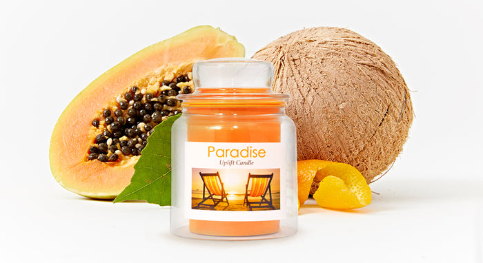 Small flameless candle with fruit in the background