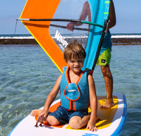 two kids windsurfing