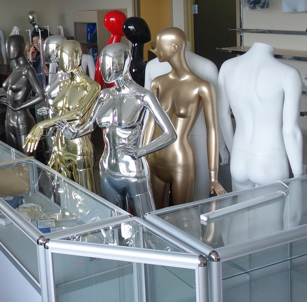 attractive mannequins behind shop counter