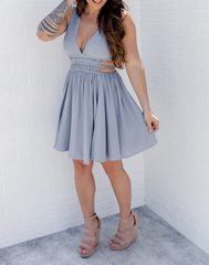 The Dany Dress - Khaleesi Blue. Light blue dress with deep v neckline, side cutouts, and flowy skirt