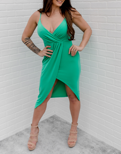 Not Feeling Shy Asymmetric Dress - Green. Bright green midi dress with spaghetti straps, crossover neckline, and asymmetric tulip skirt