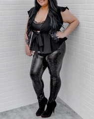 Rewrite the Stars Leggings - black faux leather leggings with a faint silvery star print