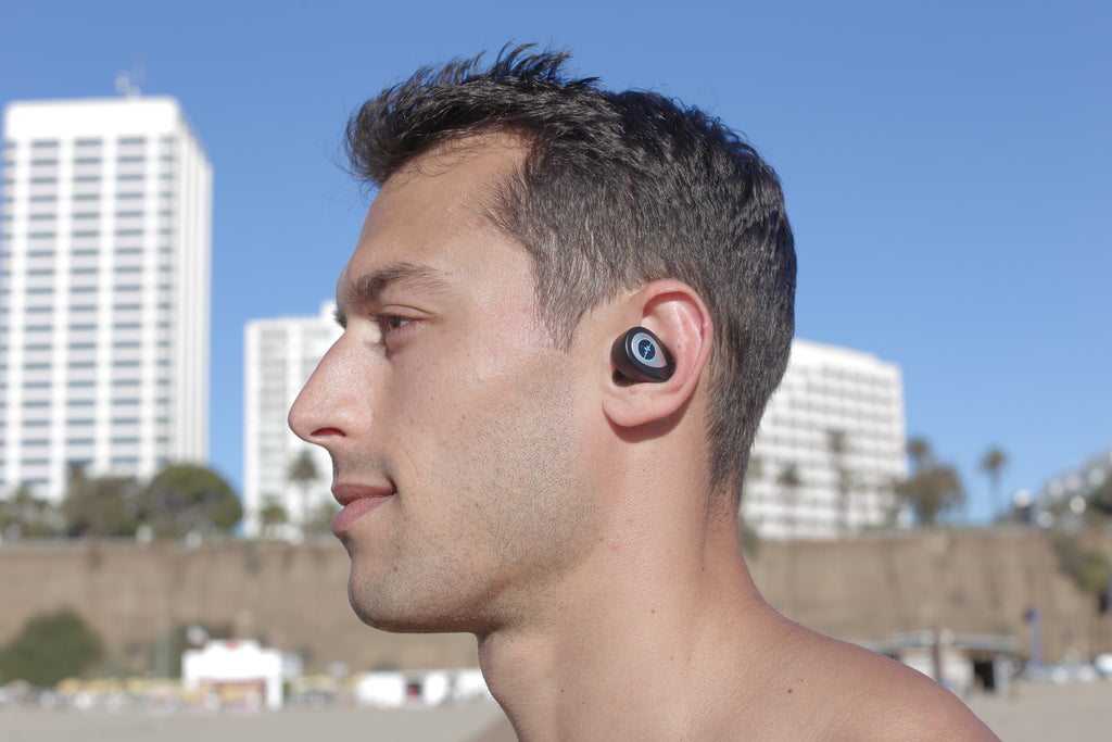 Adam Frater sporting our Vital wireless earbuds during his workout at Venice Beach.