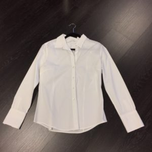 Our classic white button-down is from Calvin Klein, Size M, $21.99