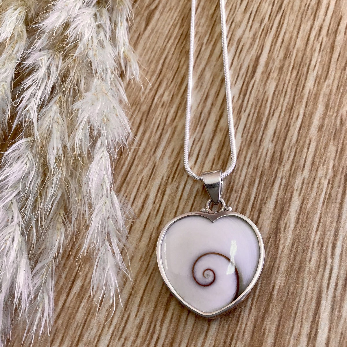 jade kiwi kaikoura sterling silver cats eye necklace pendant heart koru