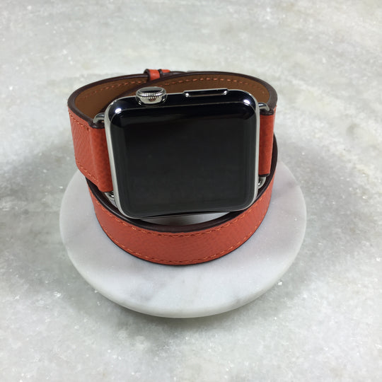 Ladies Fire Orange Double Wrap Apple Watch Leather Band by Juxli Home.  Handmade, stylish leather strap with rose gold hardware on a 40mm Apple watch on a canvas with a black and gray painting.