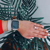 Ladies Sage Gray Double Wrap Apple Watch Leather Band by Juxli Home.  Handmade, stylish leather strap with rose gold hardware on a 40mm Apple watch on a canvas with a black and gray painting.