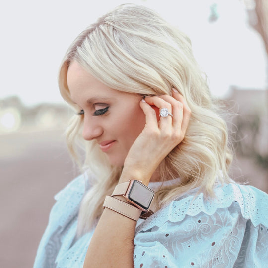 Blush Rose Double Wrap Apple Watch Leather Band for Women by Juxli Home.  Handmade, stylish leather strap with rose gold hardware on a 40mm Apple watch on a canvas with a black and gray painting.