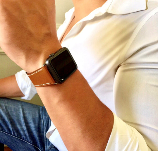 Chilli Brown Apple Watch Leather Band by Juxli Home.  Handmade, stylish leather strap with rose gold hardware on a 40mm Apple watch on a canvas with a black and gray painting.