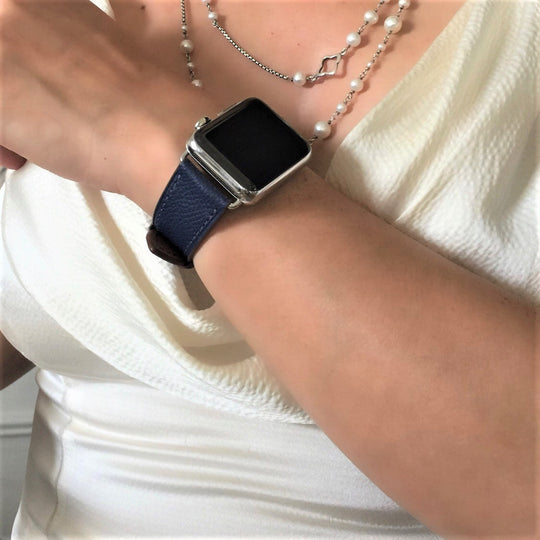 Textured Space Blue Apple Watch Band by Juxli Home.  Handmade, stylish leather strap with rose gold hardware on a 40mm Apple watch on a canvas with a black and gray painting.
