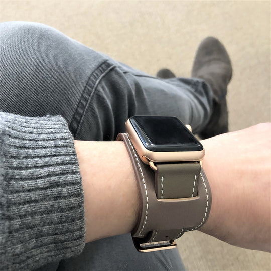 Hazel Brown Apple Watch Leather Cuff by Juxli Home.  Handmade, stylish leather strap with rose gold hardware on a 40mm Apple watch on a canvas with a black and gray painting.