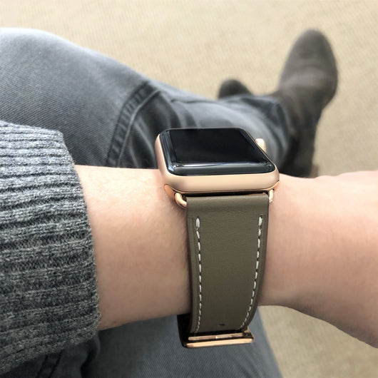 Hazel Brown Apple Watch Band by Juxli Home.  Handmade, stylish leather strap with rose gold hardware on a 40mm Apple watch on a canvas with a black and gray painting.