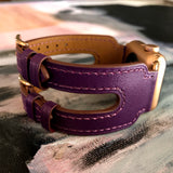Rasin Purple Apple Watch Double Buckle Cuff by Juxli Home.  Handmade, stylish leather strap with rose gold hardware on a 40mm Apple watch on a canvas with a black and gray painting.