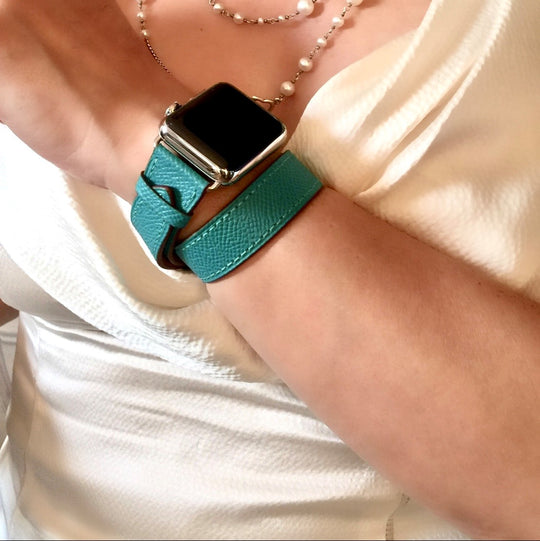 Ladies Sea Green Double Wrap Apple Watch Leather Band by Juxli Home.  Handmade, stylish leather strap with rose gold hardware on a 40mm Apple watch on a canvas with a black and gray painting.