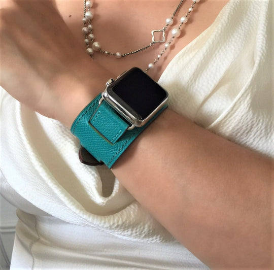 Sea Green Apple Watch Leather Cuff by Juxli Home.  Handmade, stylish leather strap with rose gold hardware on a 40mm Apple watch on a canvas with a black and gray painting.