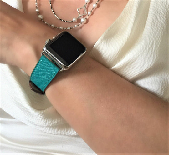Sea Green Apple Watch Textured Leather Band by Juxli Home.  Handmade, stylish leather strap with rose gold hardware on a 40mm Apple watch on a canvas with a black and gray painting.