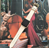 Ivory Apple Watch Leather Band by Juxli Home.  Handmade, stylish leather strap with rose gold hardware on a 40mm Apple watch on a canvas with a black and gray painting.