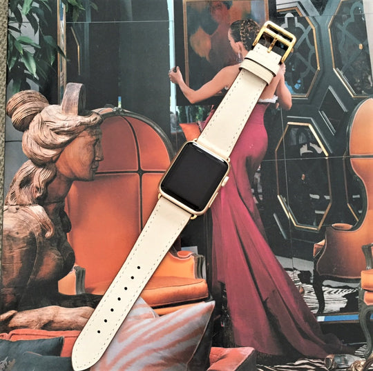Ivory Apple Watch Band by Juxli Home.  Handmade, stylish leather strap with rose gold hardware on a 40mm Apple watch on a canvas with a black and gray painting.