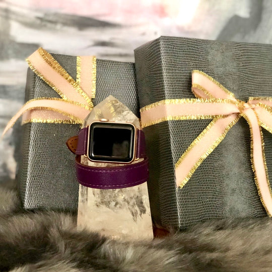 Rasin Purple Double Wrap Apple Watch Leather Band for Women by Juxli Home.  Handmade, stylish leather strap with rose gold hardware on a 40mm Apple watch on a canvas with a black and gray painting.