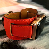 Fire Red Apple Watch Leather Cuff by Juxli Home.  Handmade, stylish leather strap with rose gold hardware on a 40mm Apple watch on a canvas with a black and gray painting.