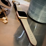 Sage Gray Apple Watch Band by Juxli Home.  Handmade, stylish leather strap with rose gold hardware on a 40mm Apple watch on a canvas with a black and gray painting.