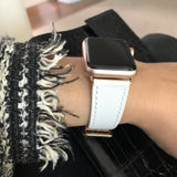 Textured White Apple Watch Band by Juxli Home.  Handmade, stylish leather strap with rose gold hardware on a 40mm Apple watch on a canvas with a black and gray painting.