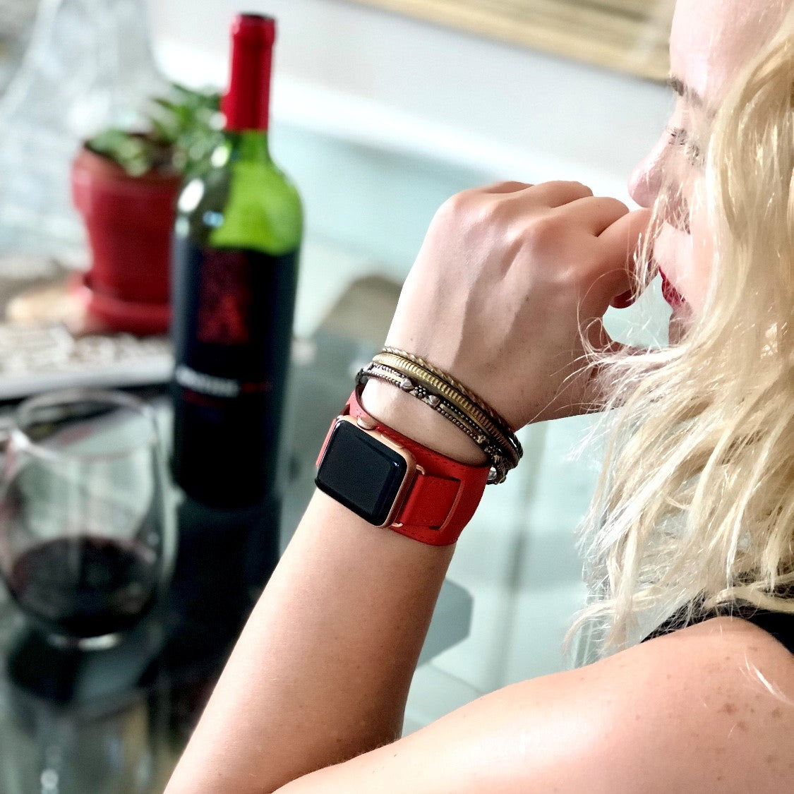 Juxli Home Red Leather Apple Watch Cuff on Woman Drinking Red Wine