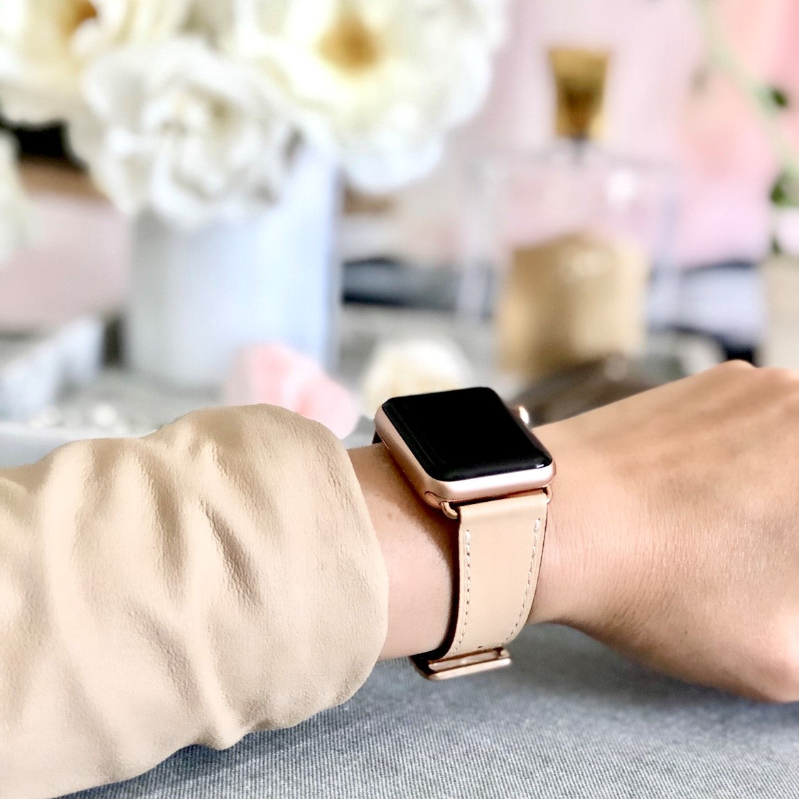 Juxli Home Blush Pink Single Tour Apple Watch Leather Band on Woman in Bedroom