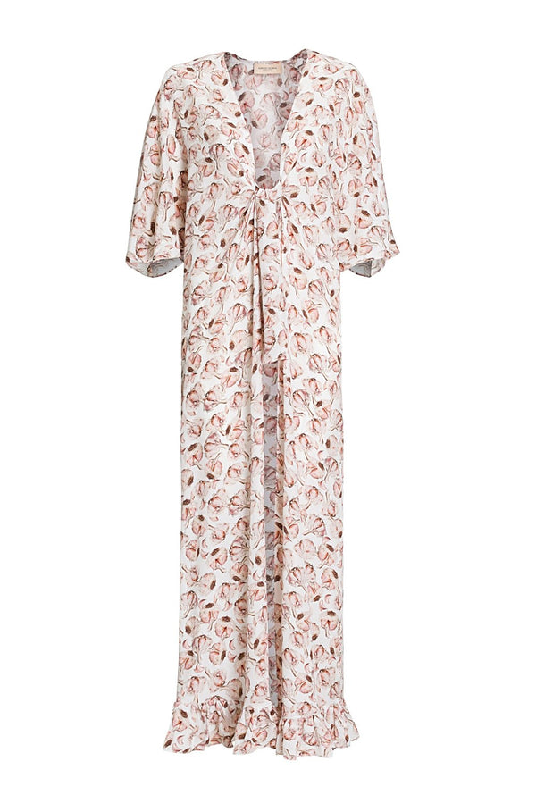 Long kaftan with deep V-neck and ruffle details is cut in a loose silhouette and falls to floor-sweeping hem