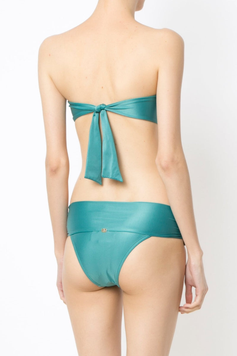 Look to Adriana Degreas for feminine styles that feel modern as they do elegant, such as this solid blue heritage bikini