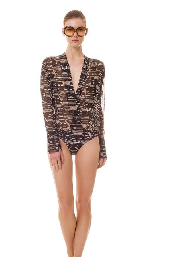 Mixing the elegance of silk and praticity of stretch fabric, this slightly transparent bodysuit features a daring V-neck and bell-shaped cuffs