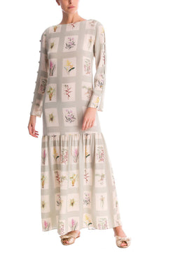 This long dress With vintage botanical illustrations is made from crepe de chine - it has lined buttons along the sleeves wich brings a retro twist