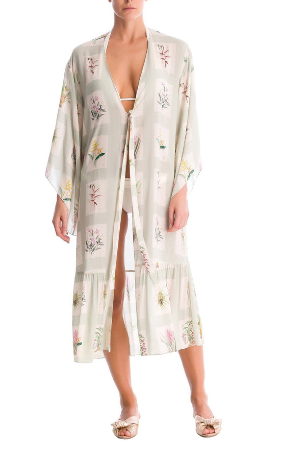 This elegant cover up is made from lightweight viscose with loose silhouette and ties at waist for your perfect fit.Wear it over a bikini after the beach