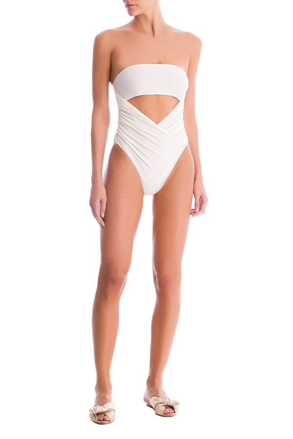 This is shaped to a bandeau silhouette with cutout in the front and high-cut legs