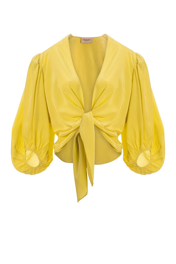 Made of silk, this long sleeve top with knotted front is an elegant choice for your next evening out