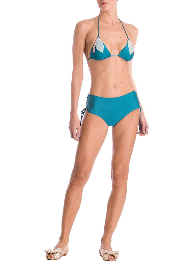 This triangle bikini is paired with an adjustable brief, making a slighted ruched, that visually slims the silhouette