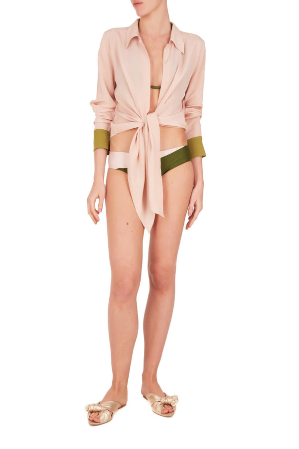 This vintage rose and green cover-up is shaped with a point collar and long sleeves that end in button-fastening cuffs. Style it with the coordinating skirt over your swimwear after the beach