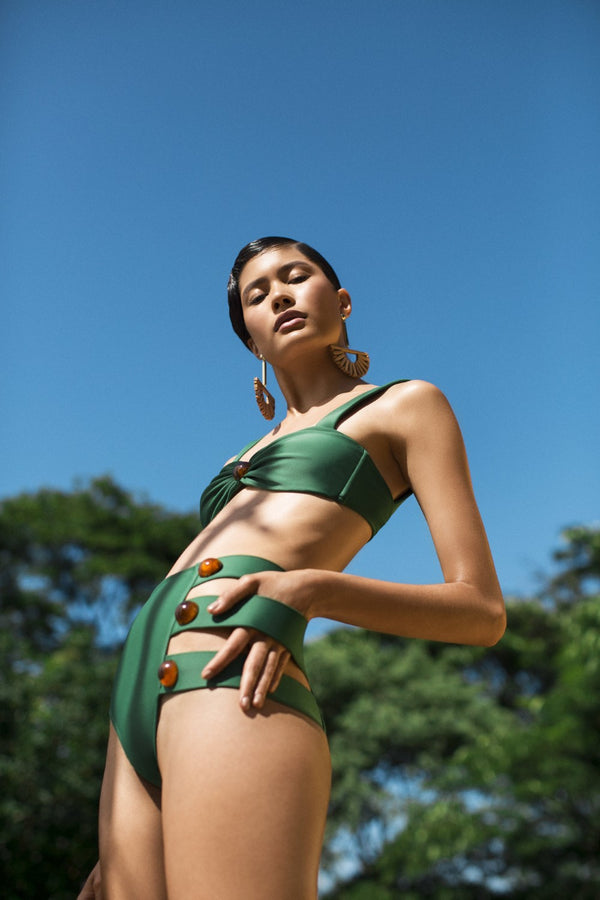 This bikini in geometric shape with side cut-outs and deColorative buttons is a modern and elegant choice for a tropical vacation