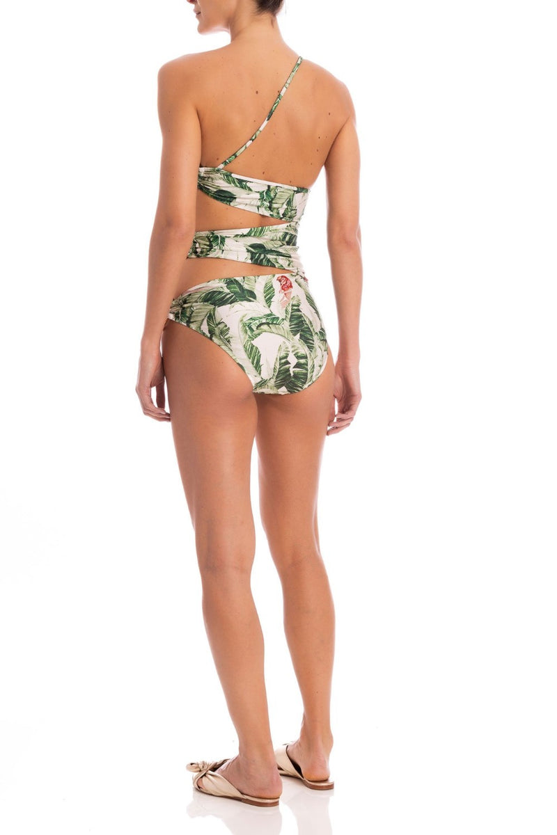 Pieces with cut-outs and acrylic details in surrealistic prints like this halterneck one shoulder swimsuit are perfect for your next tropical summer escape