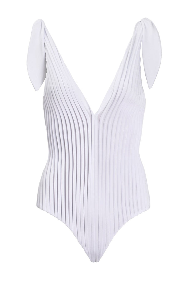 This swimsuit with deep V-neckline and plissé details is made in Brazil and is truly an object d´art
