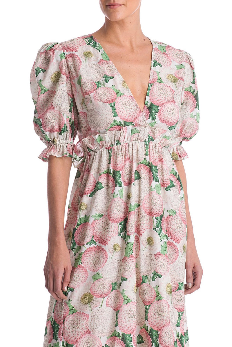 Inspired from vintage silhouettes, this dress is crafted from silk, to an airy, balloon sleeved silhouette with subtly padded shoulders- the wrap-around shape is very practical and you can wear also as a cover up