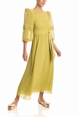 This lady like dress is crafted from fluid fabric and shaped with puff sleeves and self-tie matching belt for an elegant approach